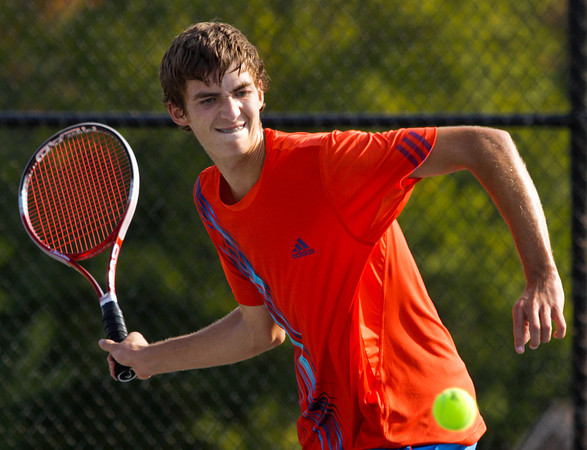 Silver Creek sophomore Jake Steele moves to return the ball to Borden junior Josh Vollstedt during their No. 1 singles match at the Silver Creek Tennis Sectional Championship in Sellersburg on Thursday. Steele won the match in two sets, 6-3, 6-3. Staff photo by Christopher Fryer