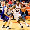New Albany forward DeAnthony Warren drives to the basket during the Bulldogs' home game against Seymour on Friday. Staff photo by Christopher Fryer
