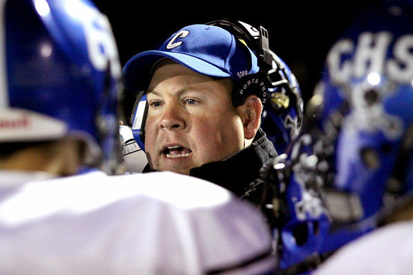 Charlestown head coach Jason Hawkins talks to his offense during a timeout in the Sectional championship. Staff photo by C.E. Branham