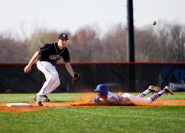 Silver Creek junior Nick Paynter slides safely into third base past Clarksville freshman Clayton Haus during their game in Sellersburg on Thursday. Silver Creek won the game in five innings, 14-0. Staff photo by Christopher Fryer