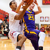 New Albany center Nick White fights for a rebound during the Bulldogs' home game against Scottsburg on Saturday. New Albany won the game, 77-59. Staff photo by Christopher Fryer