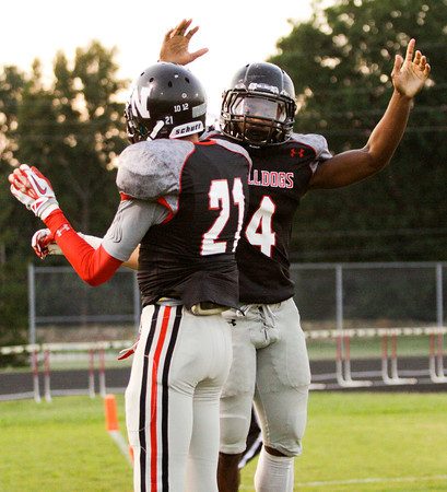 New Albany running back Tuwan Payton is congratulated by wide receiver Seth Farris after scoring a touchdown during their home game against Jennings County on Friday. Staff photo by Christopher Fryer