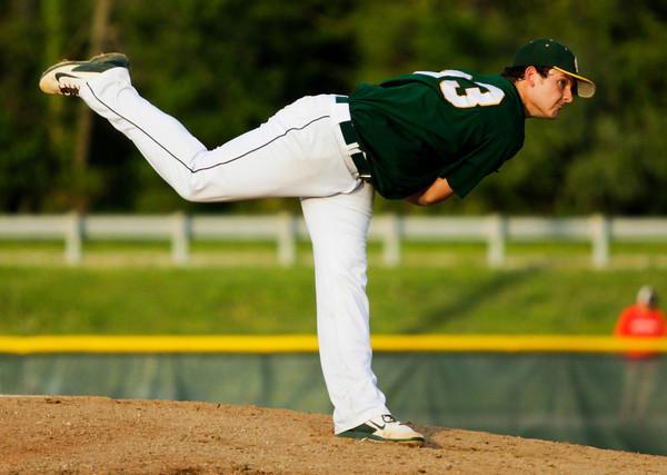 Floyd Central's Kyle Beach pitches during the Highlanders' 7-6 loss to Jeffersonville at home Monday. Staff photo by Christopher Fryer