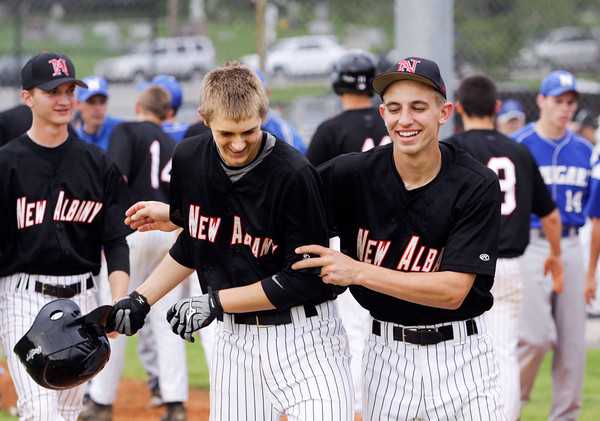 New Albany's Jack Shine, left, is congratulated by Shane Robinson after hitting a grand slam home run during the fifth inning to end their game against North Harrison in the Sajko Invitational on Friday. New Albany won the game, 14-2. Staff photo by Christopher Fryer