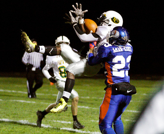 Defensive back Gabriel Kennedy attempts to intercept a pass intended for wide receiver Chaz Aman-Kurtz during Floyd Central's sectional championship game at Whiteland on Friday. Aman-Kurtz caught the ball on the play. The Highlanders lost the game, 41-20. Staff photo by Christopher Fryer