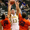 Floyd Central sophomore Colton Kimm scores against Silver Creek Saturday night. Staff photo by C.E. Branham