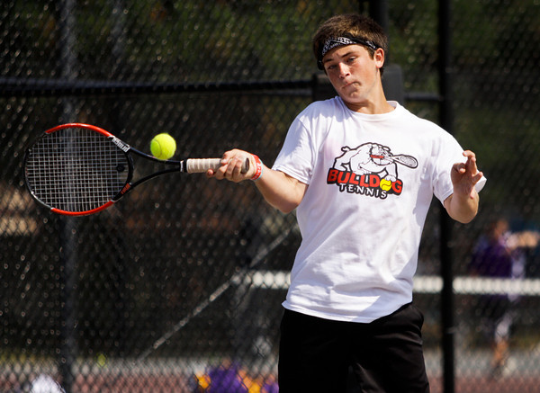 New Albany junior Tanner Goller returns a shot during his No. 1 doubles match with junior Jake Kennard against Providence freshman Ben Arnson and junior Ryan Day at the New Albany Boys' Tennis Invitational on Saturday. Staff photo by Christopher Fryer