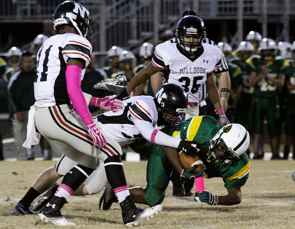 Floyd Central running back Garry Posey is brought down by the New Albany defense during the first half of their game at Floyd Central on Friday. New Albany won the game, 28-27. Staff phtoo by Christopher Fryer