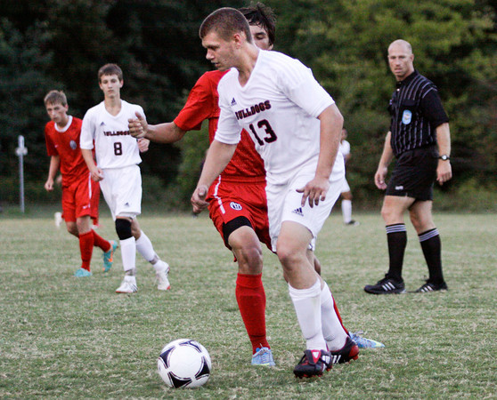 New Albany senior Ryan Shipton moves the ball downfield during their home game against Jeffersonville on Tuesday. Jeffersonville won the game, 2-1. Staff photo by Christopher Fryer