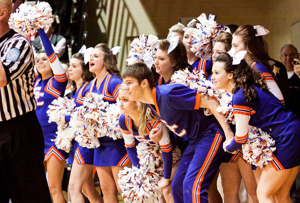 The Silver Creek cheerleaders look on in anticipation as center Christian Reed takes the first of two free-throws that gave the Dragons the lead in the final seconds of their 37-36 victory over Brownstown in the championship round of the North Harrison Sectional on Saturday. Staff photo by Christopher Fryer