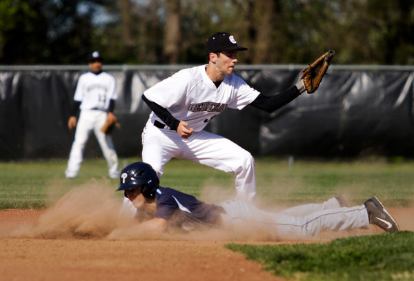 Providence's Parker Graf slides safely into second base on a steal during the Pioneers' 13-0 win at Clarksville on Wednesday. Staff photo by Christopher Fryer
