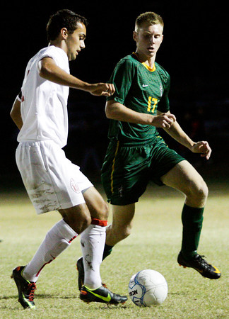 Jeffersonville senior Jordan Vejar and Floyd Central senior Grant Naville fight for possession of the ball during their game in the Indiana High School Athletic Association Boys Soccer Sectional tournament at Floyd Central on Wednesday. Jeffersonville won the game, 3-0. Staff photo by Christopher Fryer