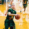 Floyd Central guard Austin Newell drives to the basket during the Highlanders' game at Clarksville on Tuesday. Staff photo by Christopher Fryer