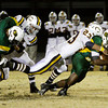 Floyd Central running back Garry Posey is brought down by Castle free safety Braden Sims during the first half of their game in the Class 5A Football Sectional at Floyd Central on Friday. Staff photo by Christopher Fryer
