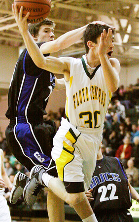 Floyd Central guard Aiden Cora is fouled during their home game against Charlestown on Friday. Floyd Central won the game in double overtime, 81-79. Staff photo by Christopher Fryer