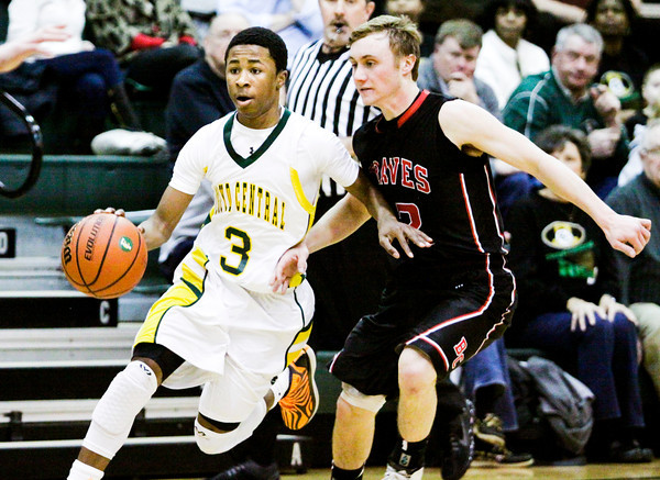 Floyd Central guard Myles Ervin moves the ball downcourt during the Highlanders' home game against Brownstown Central on Tuesday. Staff photo by Christopher Fryer