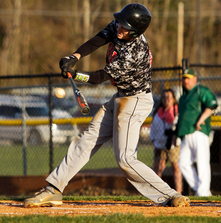 Borden's Brian McGee connects for a single during the Braves' 8-7 victory over Floyd Central on Thursday. Staff photo by Christopher Fryer