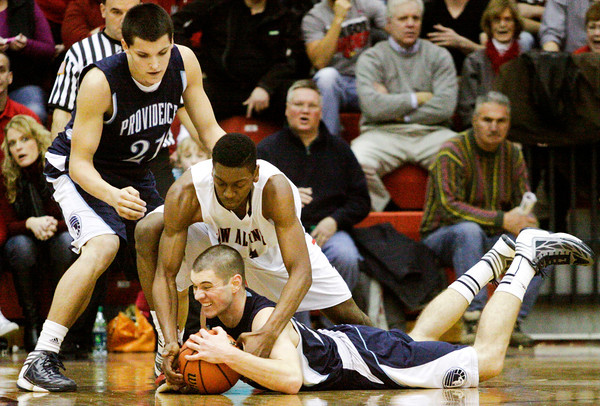 New Albany center Anthony Edwards and Providence center George Knott fight for a loose ball during their match up at New Albany on Friday. Staff photo by Christopher Fryer