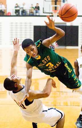 Floyd Central guard Myles Ervin is fouled by Clarksville forward Aham Yennes during their game in Clarksville on Tuesday. Staff photo by Christopher Fryer