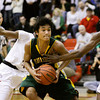 Floyd Central guard Truong Allen drives the ball down court during their away game against New Albany on Friday. Staff photo by Christopher Fryer