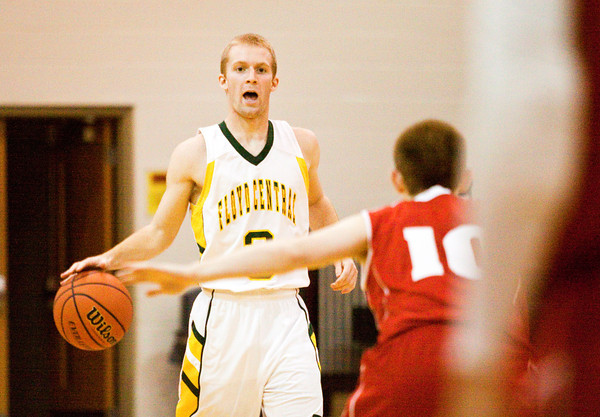 Floyd Central guard Drew Hussung moves the ball down court during their home game against Madison on Saturday. Madison won the game, 63-41. Staff photo by Christopher Fryer