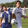 Charlestown player David Rodriguez and Silver Creek player Noah Spencer get tangled up purssing the ball in a match Tuesday at Silver Creek. Staff photo by C.E. Branham