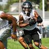 New Albany senior Ravon Wright runs the ball on a play during the team's first practice of the season on Monday afternoon. Staff photo by Christopher Fryer