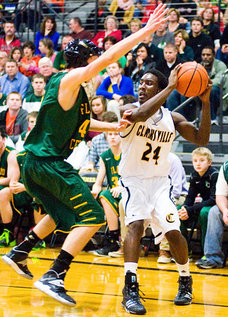 Clarksville guard Marquise Parrish moves to pass out of pressure during the Generals' home game against Floyd Central on Tuesday. Staff photo by Christopher Fryer