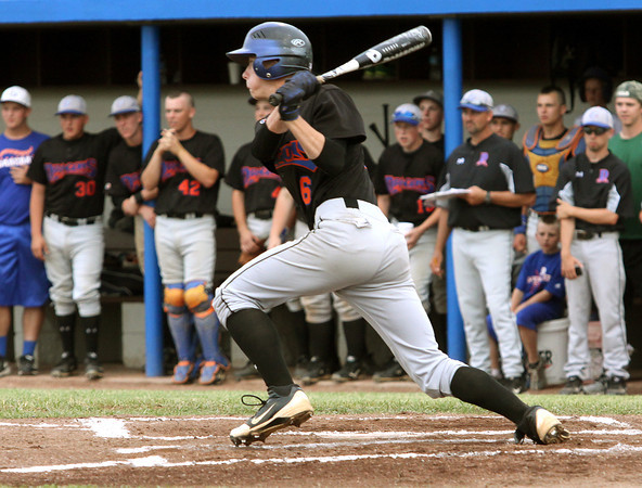 Silver Creek pitcher Lucas Barnett rips a RBI single against Charlestown in the championship game of the 3A sectional at North Harrison. Staff photo by C.E. Branham