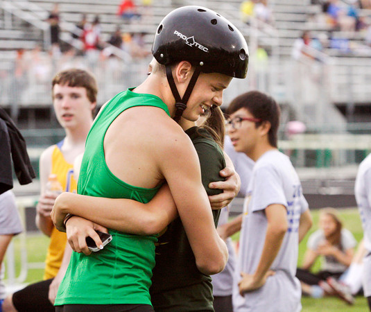 Floyd Central junior Jacob Marguet hugs his girlfriend Katelyn Goodman after completing a record breaking vault of 14 feet during the Floyd Central sectional track meet on Thursday. Staff photo by Christopher Fryer
