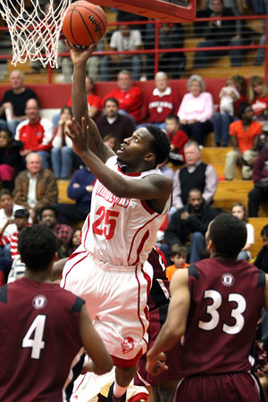Jeff senior Kortrell White scores against Ballard Tuesday night. The host Red Devils lost to the Bruins 69-67. Staff photo by C.E. Branham