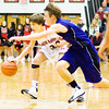 New Albany guard Isaac Hibbard moves the ball down court during the Bulldogs' home game against Seymour on Friday. Staff photo by Christopher Fryer