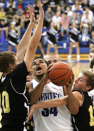 Charlestown forward Darren Taylor is fouled by Henryville Tuesday night. Staff photo by C.E. Branham