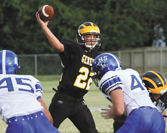 Clarksville quarterback Aidan McEwan throws a pass over the Charlestown defense Friday night at Clarksville. Staff photo by C.E. Branham