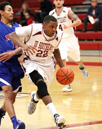 Indiana University Southeast junior guard drives to the hoop in a game against Miami-Middletown Wednesday night. Staff photo by C.E. Branham