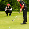Jeffersonville senior Jordan Lacy studies his upcoming shot while New Albany freshman Addison Greenwell putts during the Southern Indiana Open at Hidden Creek Golf Club on Saturday. Staff photo by Christopher Fryer