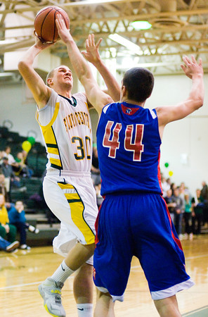 Floyd Central forward Zane Nichols goes up for a shot during the Highlanders' home game against Jennings County on Tuesday. Staff photo by Christopher Fryer