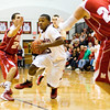 New Albany guard Chad Hudson drives to the basket during their home game against Madison on Friday. Staff photo by Christopher Fryer