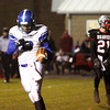 Charlestown receiver Gage Brafford pumps his fist after a touchdown reception Friday night. Staff photo by C.E. Branham