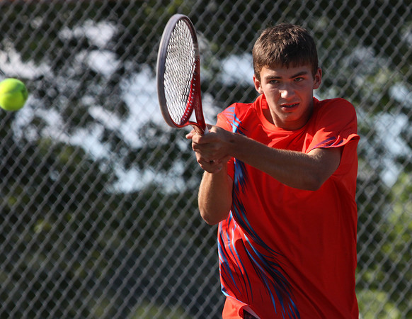 Silver Creek no. 1 tennis player Jake Steele returns volley to Providence opponent Will Andres in their match Tuesday. Staff photo by C.E. Branham