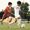 Silver creek player Alan Cruz dribbles down field in a match with Rock Creek thursday. Staff photo by C.E. Branham