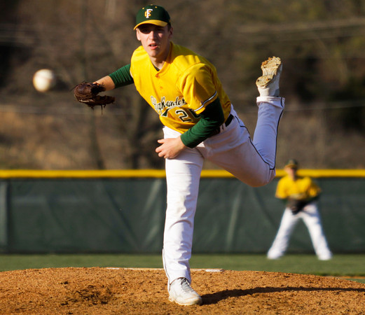 Floyd Central's Chas Adams pitches during the Highlanders' home game against Borden on Thursday. Borden won the game, 8-7. Staff photo by Christopher Fryer