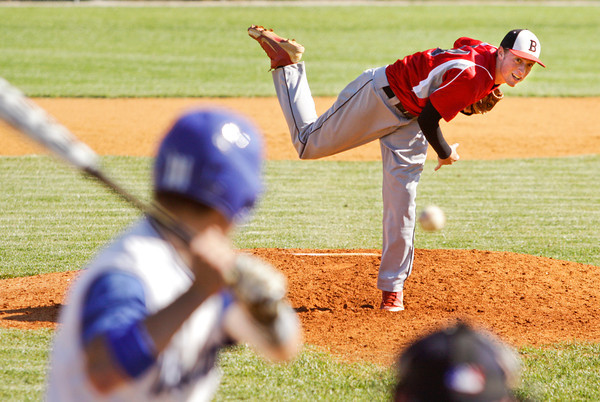 Borden junior Garrett Vick pitches during their game against New Washington in the Lanesville sectional tournament on Friday. Staff photo by Christopher Fryer