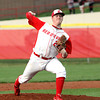 Jeffersonville pitcher Mark Meyer works the mound for the Red Devils Wednesday night against New Albany. Staff photo by C.E. Branham