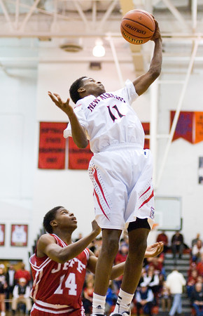 New Albany senior Javen Reeves comes down with a rebound during the Bulldogs' home game against Jeffersonville on Friday. New Albany won the game, 67-56. Staff photo by Christopher Fryer