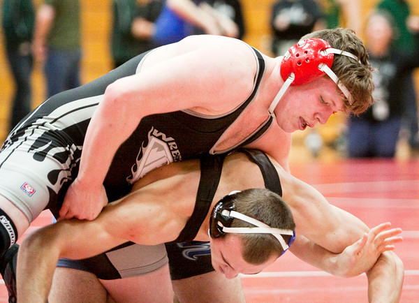 Jeffersonville junior Chase Thompson wrestles Charlestown junior Tyler Olsen during their 182-pound match at the Jeffersonville Sectional on Saturday. Thompson pinned Olsen to win the match. Staff photo by Christopher Fryer