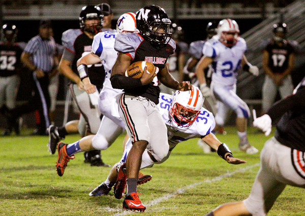 New Albany running back Tuwan Payton moves the ball downfield during their home game against Jennings County on Friday. Staff photo by Christopher Fryer