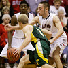 New Albany forward Garrett Arnold covers Floyd Central guard Drew Hussung during their game at New Albany on Friday. Staff photo by Christopher Fryer