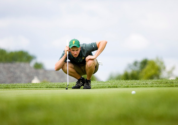 Floyd Central's Connor Welch studies his putt on the ninth green at Champions Pointe Golf Club during the Providence Regional on Thursday. Staff photo by Christopher Fryer