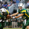 Floyd Central quarterback Colton Kimm hands the ball off to running back Gabriel Kennedy during their home game against Seymour on Friday. Staff photo by Christopher Fryer